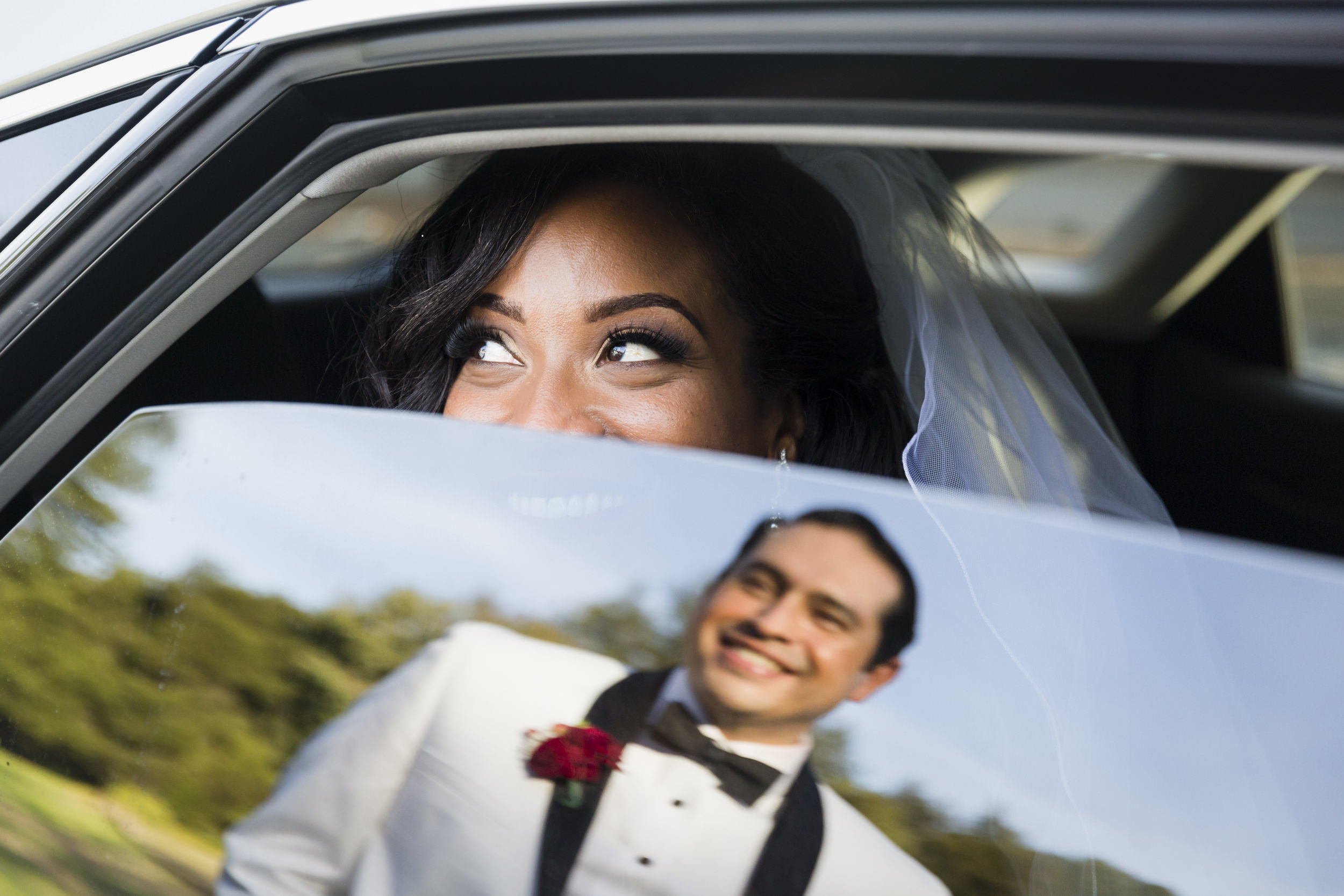 groom-reflection-window-looking-at-bride-1.jpg
