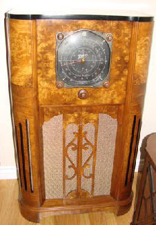 Pictured here is a fabulous 1937 Zenith 12U159. The next model up for 1937 was a 16 tube Stratosphere. The baby sister to the 12U159 is the 12U158 listed on my for sale page and now sold. The radio chassis for the 159 and 158 are the same. The 12U159 has a second 6 inch tweeter speaker. The 12U159 cabinet is made of 3 different book matched walnut veneers and has 3 inlays strips. The grille is very ornate in design. When I purchased the radio the wood cabinet was flawless. That is the wood had no damage, no chips, dings or marks to the wood of any kind. But the previous owner brushed a heavy coat of Varathane all over the original finish. Well it was a blessing in disguise. This finish protected the cabinet. I stripped this finish off to the bare wood and refinished it's to it's original look.