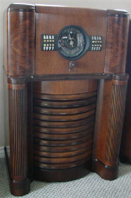 """1939 Zenith 12s370 is pictured here. Big Bertha is the given name by collectors. This was Zenith first year for automatic push button tuning. Coin named """"Radiorgan"""". Zenith claimed 64 tone variation from the push-pull tone control. Notably one of the best sounding radios in my collection. Zenith did a great job in producing, number one, a great sounding radio for 1939 and installing in a cabinet that resonates the sound to perfection."""