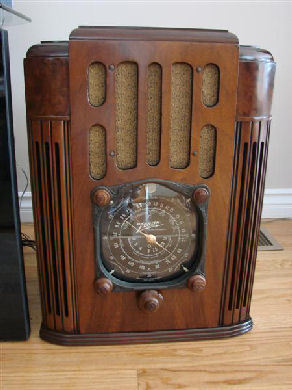 "This is a stunning and near perfect 1937 Zenith, model 10S130 tube radio. It is about as nice as you will ever likely find. This one has been completely restored and refurbished inside and out and from top to bottom. This is the top of the line tombstone model for 1937. The book matched walnut veneered cabinet is beautifully finished with a near flawless lacquer finish. Every effort was taken to reproduce original look of this radio. The cabinet was finished using Mohawk sealer and lacquer. Wood repairs were made as necessary. Tone lacquer was used on the trim wood to keep with the original appearance. The grille cloth is a reproduction of the original pattern. The famous black Zenith ""Black Dial"" is in mint condition as is the dial glass. The brass pointer and the red second hand are perfect and moves nicely around the dial. The four original wood Z knobs are also perfect."
