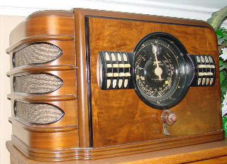 """Pictured to the right is a 9S324. Zenith for 4 years made some very large table radios. The chassisis the same used in a console. Zenith installed 7, 8, 9, 10 and 12 tube console chassis in these table sets. Very powerful radios driving an 8 inch speaker. Kind of over kill. These radios are uncommon today. I am sure Zenith made very few. They were not very good sellers. As a table radio they took up too much space. Now they are highly collectible. This was Zenith first year for automatic push button tuning. Coin named """"Radiorgan"""". Zenith claimed 64 tone variation from the push-pull tone control."""