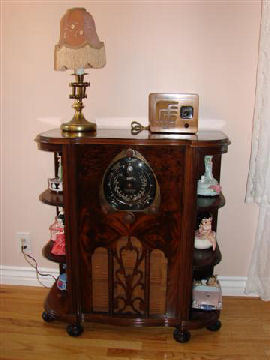 """This Zenith model 7S261 is a very rare model. In my 20 years of collecting I have only seen 2 others and they were on the internet, not in person. It is a very short cabinet, only 32 inches high. My thought was it was for a child's room. In 1938 you needed to be well off to purchase this set for your son or daughter. The grille cut out is the same found on the 15U270. This radio is also a factory mistake. The original paper tag glued on the under side of the chassis mounting board is marked 7S260, and the chassis has the same marking. When I purchased this radio, sadly this radio was painted yellow and a large 15"""" hole was cut out to house a stereo. You would never know now by just looking at it."""