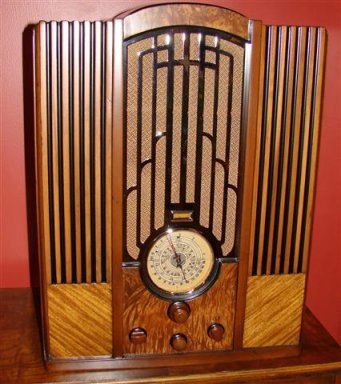 """Zenith model 835. This is the top of the line tombstone for 1935. And the top of the line of the chrome grille models. Zenith only made 3 chrome grille radios and this is the Holly Grail of them all. It sports 10 tubes and a 10"""" speaker. It has a big sound just like a console of the time. As you can see in this web page I have the complete set of 3 chrome grilles."""