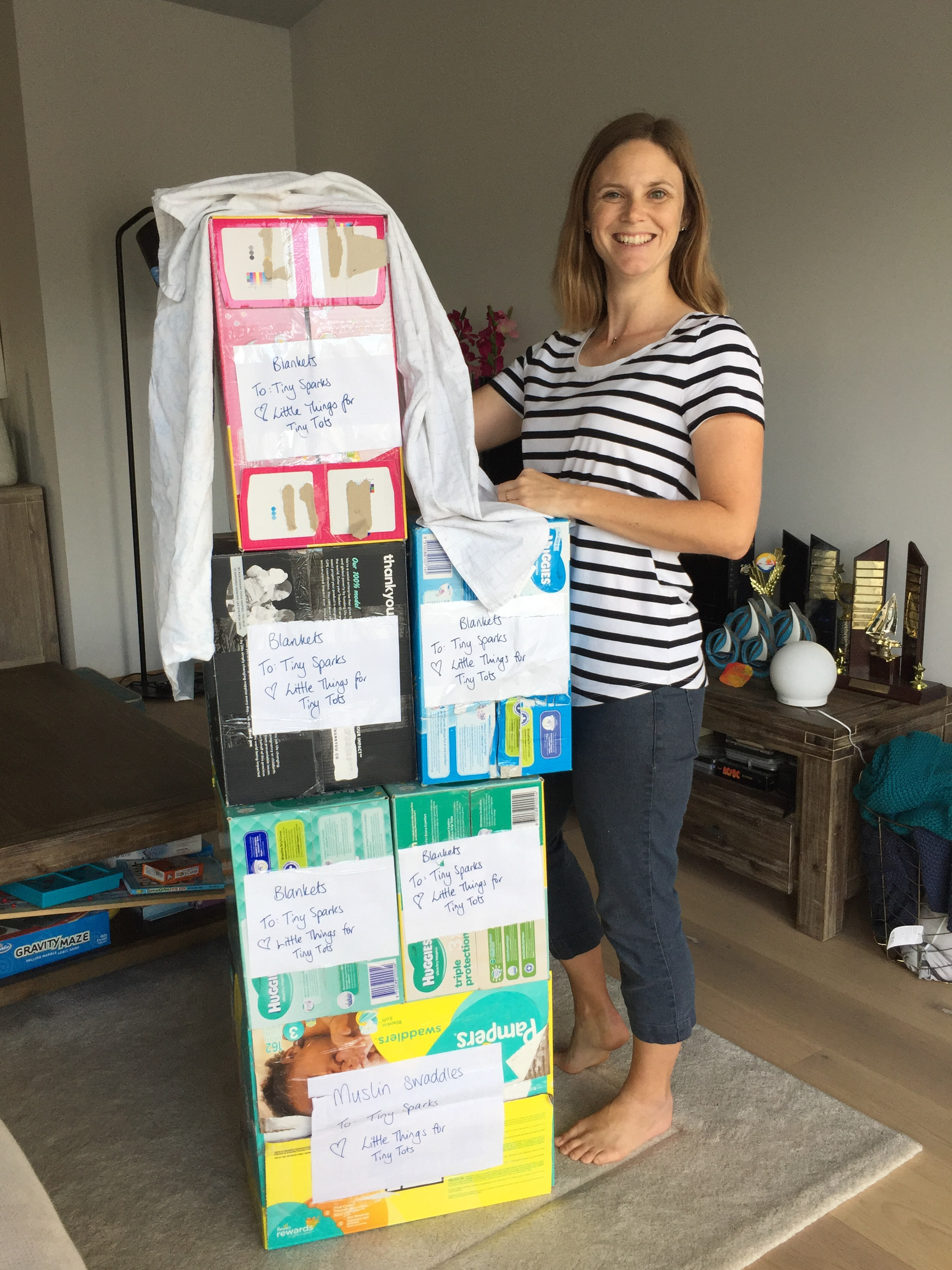 Wow, what a donation! Amber's height in wraps! That's 6 nappy boxes full of wraps!