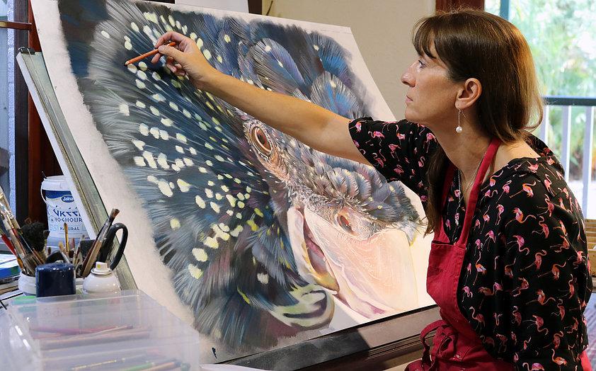 Exhibiting artist Sally Edmonds at work in her studio