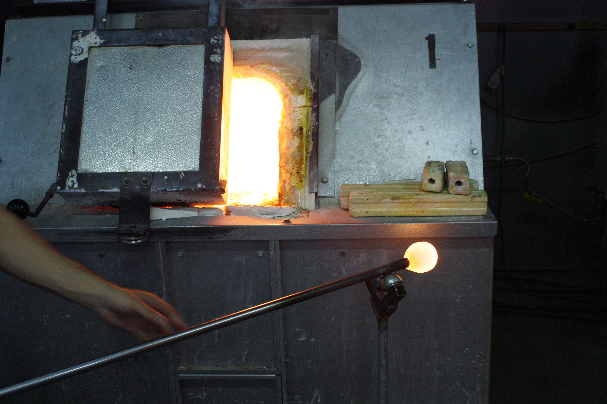 Once he's pulled out the glass that sticks to the end of this metal rod, he must spin it constantly. It's crazy! The glass never stops moving until he pops it off at the end of the process. I'm still not sure how his hands don't give out after four straight hours of glassblowing.
