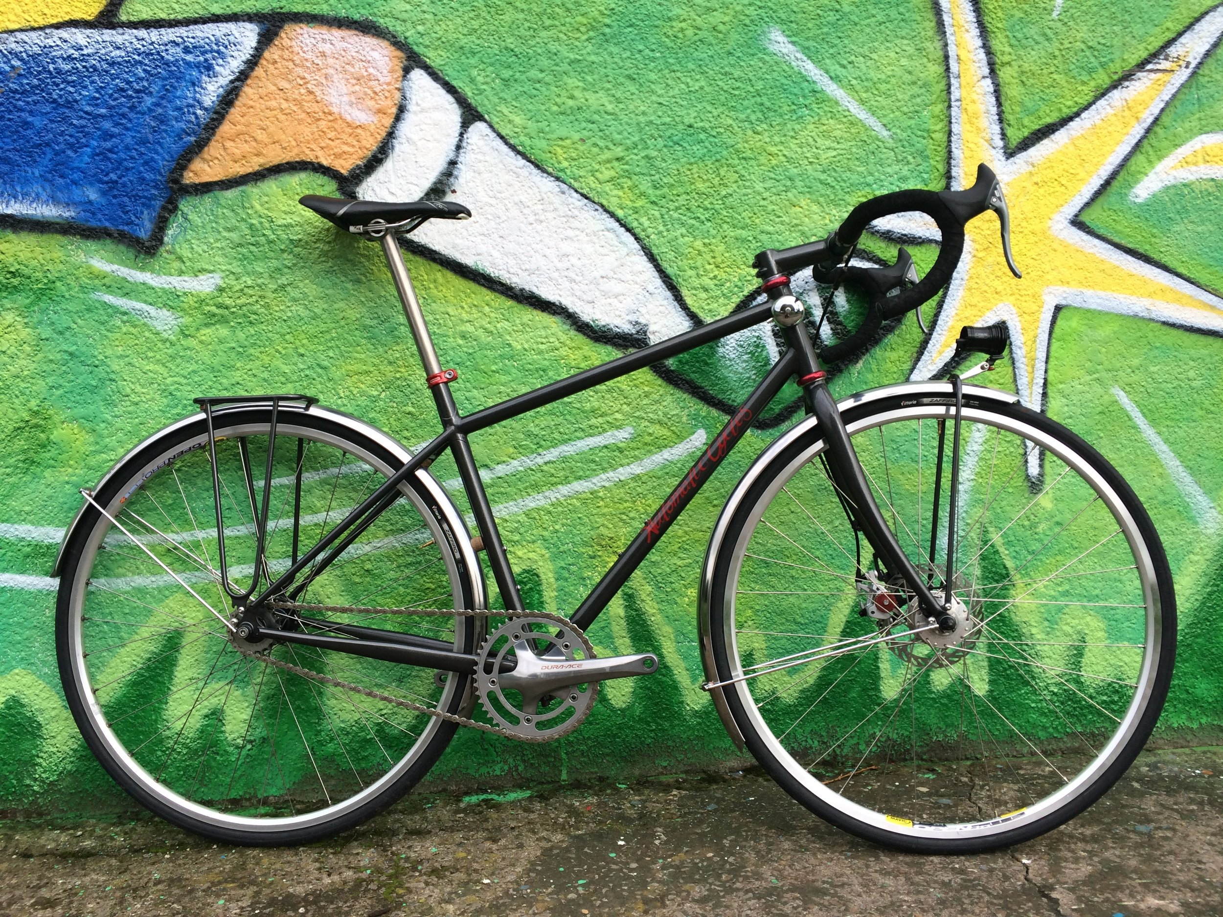 John's Commute bike  fixed gear compact frame for daily use on roads and dirt tracks. Custom built rack and Exposure Revo mount.