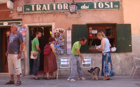 In summer, when they put tables outside in the street, there are few more picturesque dining backdrops in Venice.