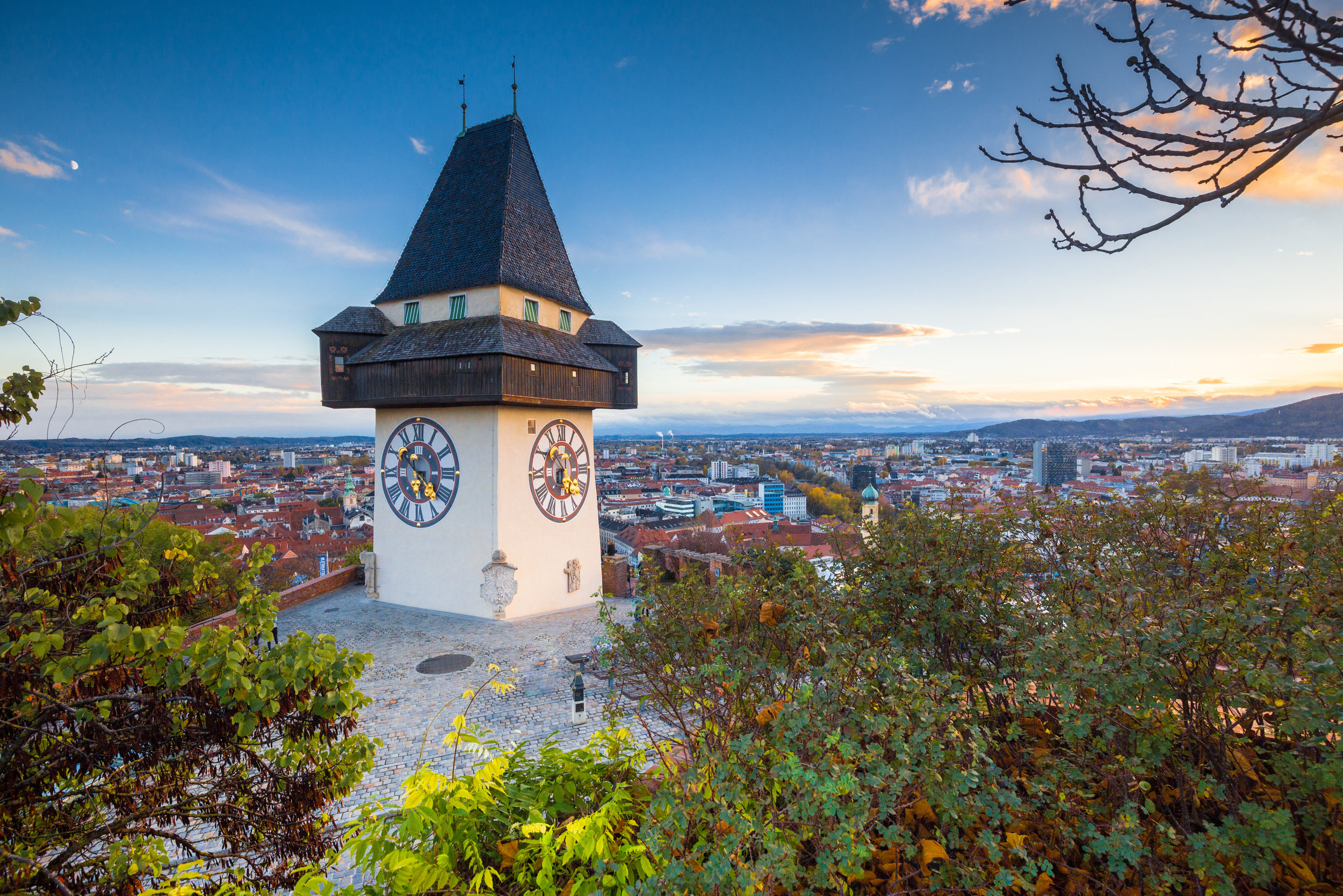 Graz clock tower at sunset, Graz, Styria, Austria