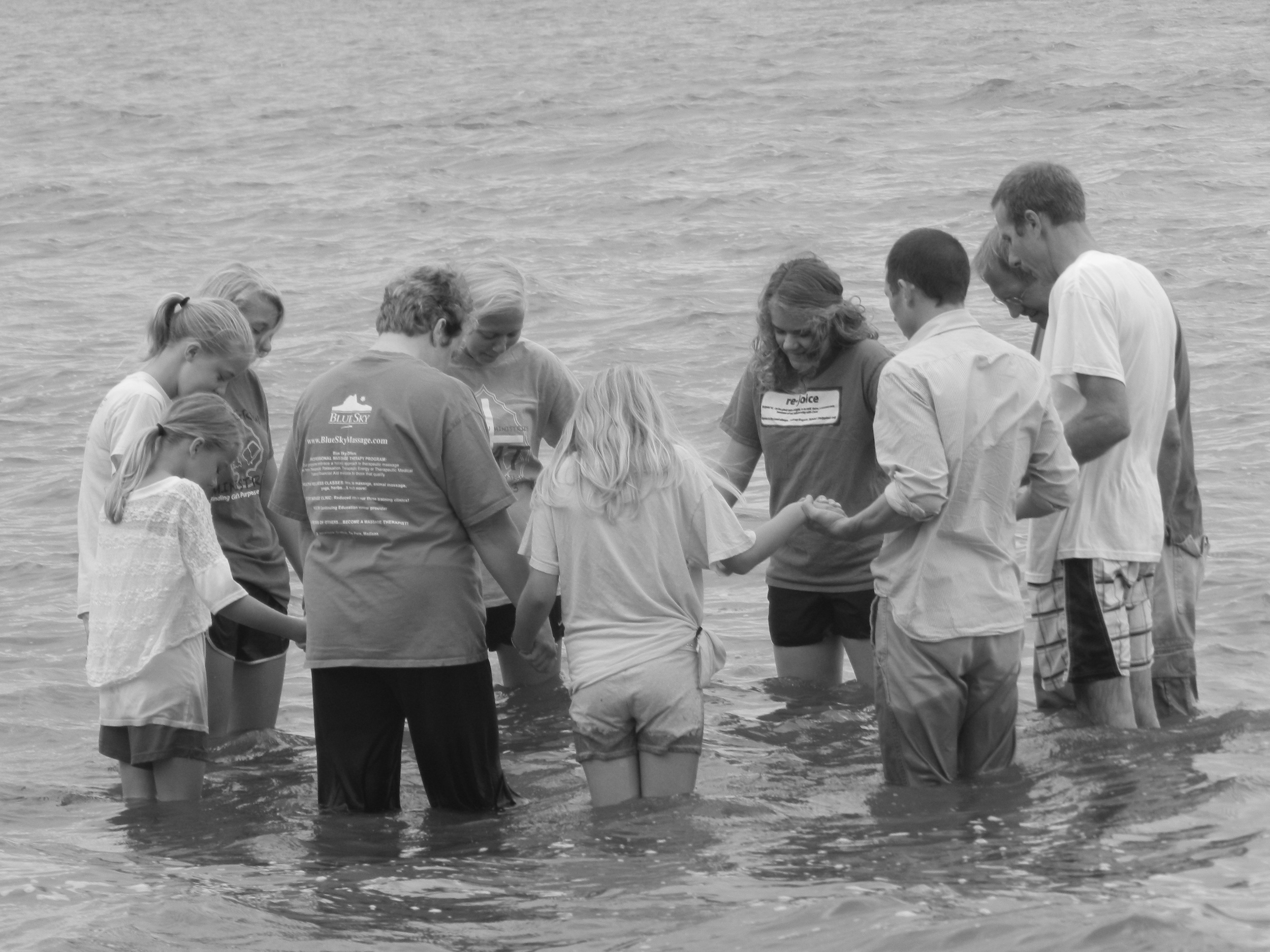 Randy Birschbach being baptized then baptizing his wife and 6 daughters in Lake Winnebago