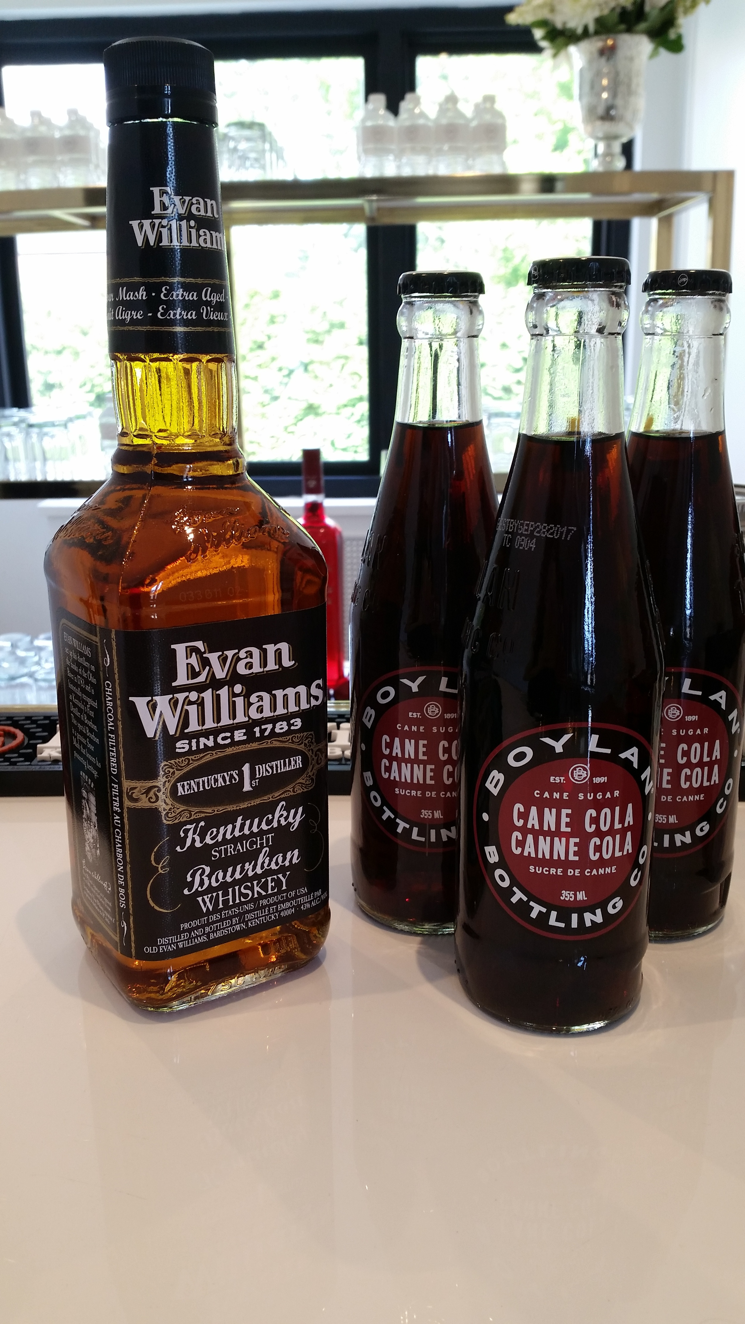 Evan Williams Bourbon Whiskey is amazing on its own or in an Old fashioned but is delightfully complimented with a sugar cane cola. We use Boylan cane cola.