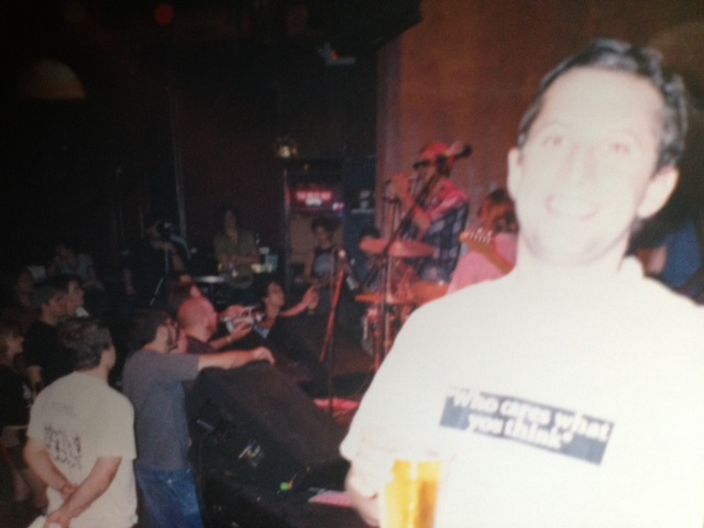 Ben with Mike Watt on stage in the background.