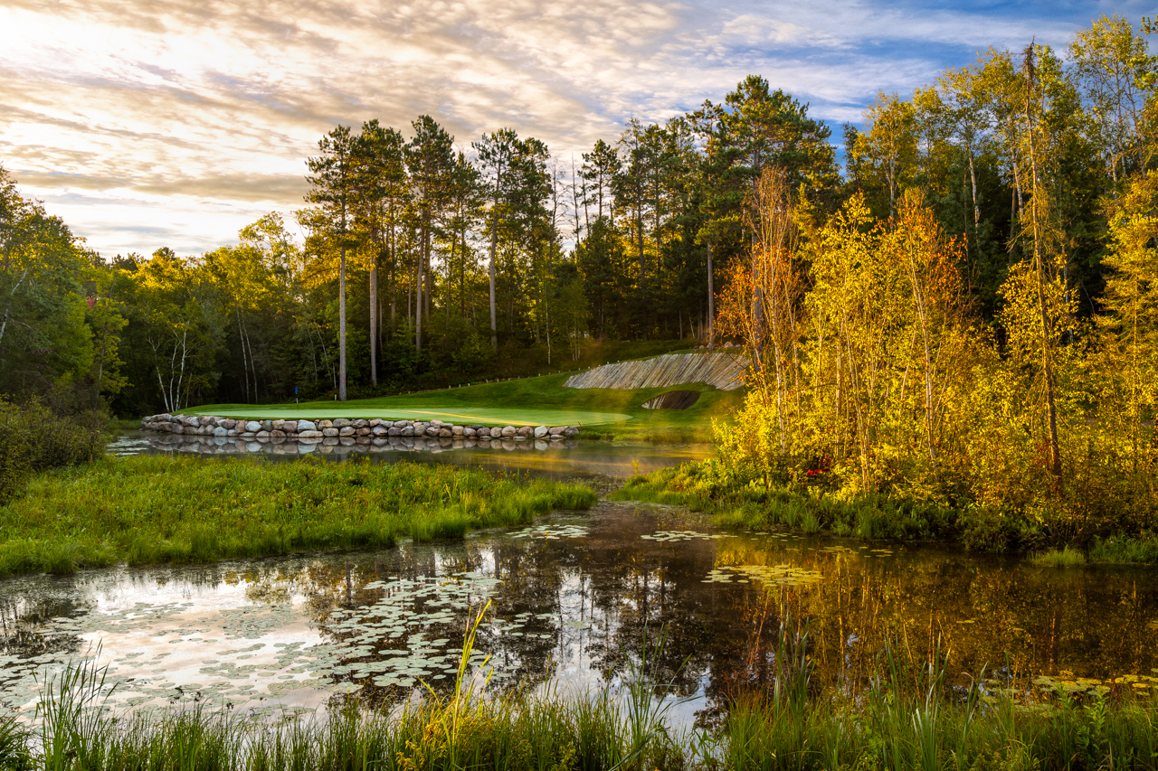 One of the many looks of the signature hole at The Pines.  Hole 7, Lakes: Beautiful light seen from the forward tees.