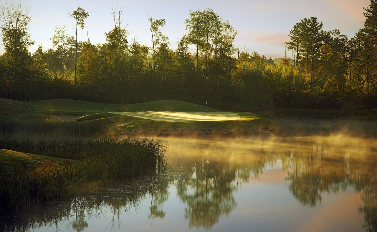 Hole 11 A cool morning with steam rising from the pond.
