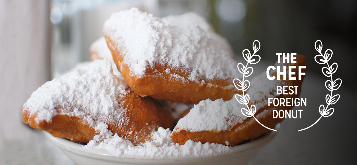 Cafe du Monde —Chef      In Chef   , Jon Favreau's character introduces his son to the legendary French style beignets at Cafe du Monde. As you devour at home, remember, you're never going to have your first beignet again.