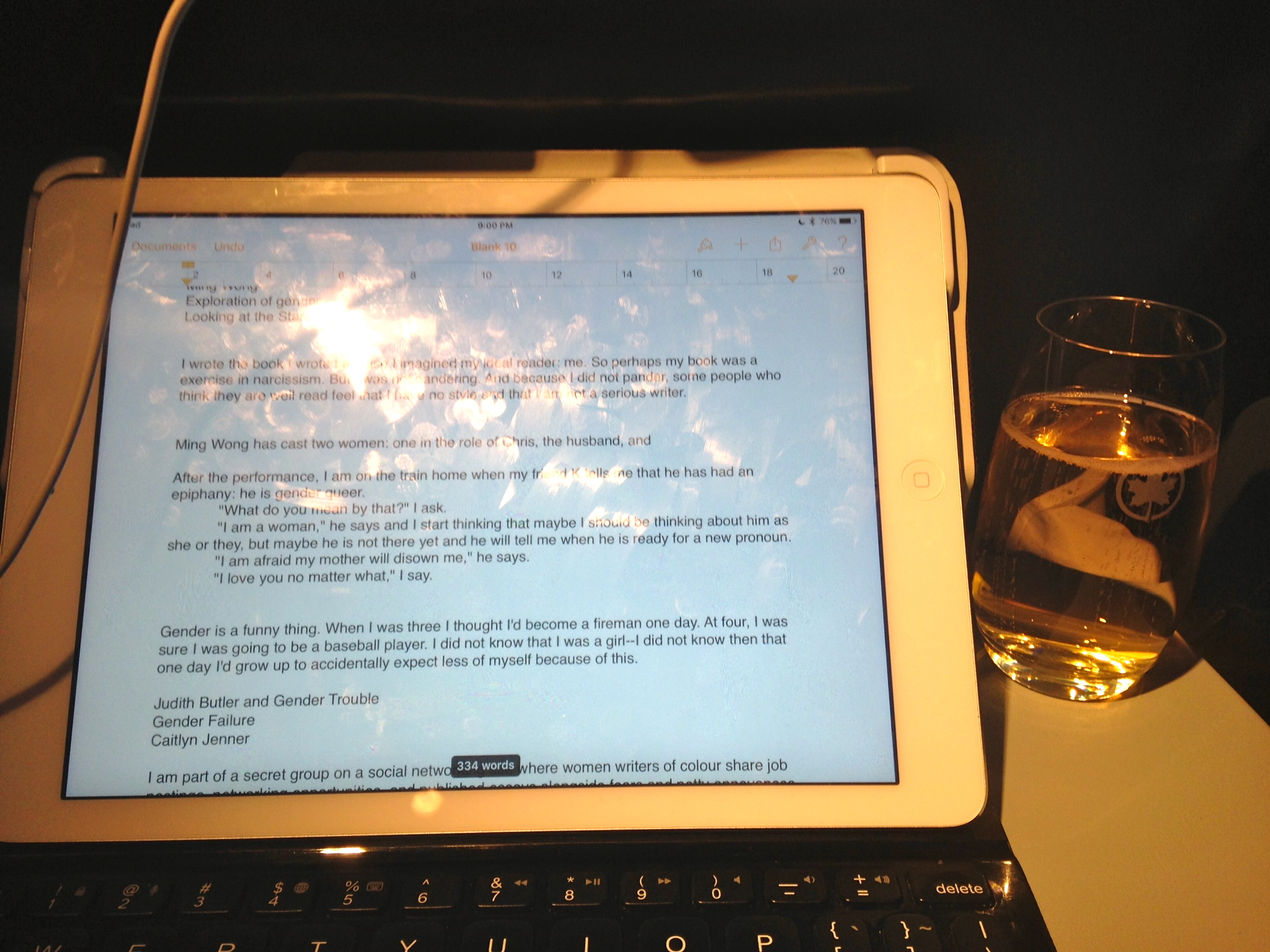 December 15, 2015: (right) There's a chance that this glass of Champagne is the last drink I'll ever have. (left) On the iPad, a messy set of notes and little scenes for an essay I am writing about gender. I'm showing you raw copy, which feels like I'm appearing before you naked while confessing every bad thing I've ever done.