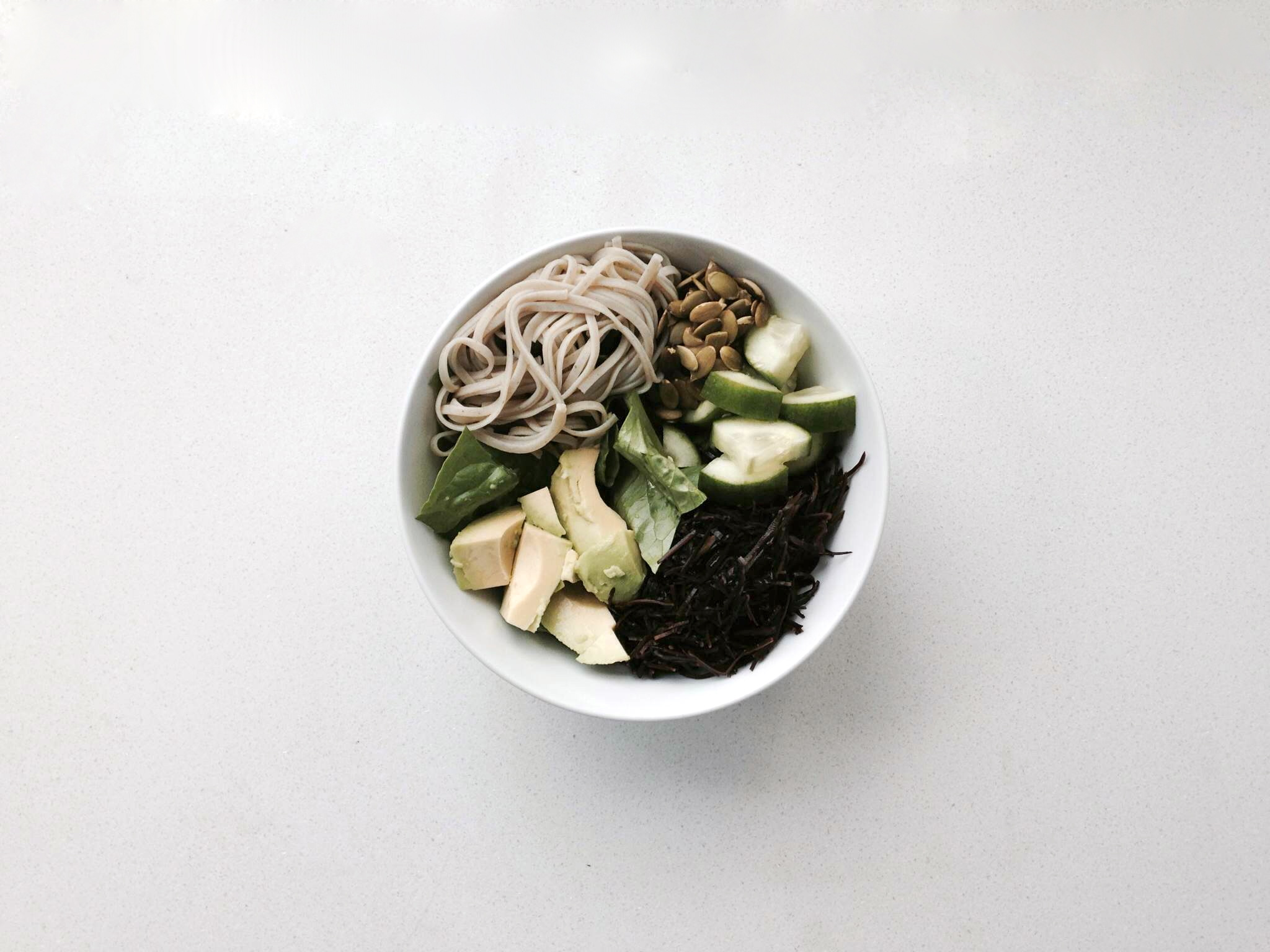 Soba, raw pumpkin seeds, cucumber, arame sea vegetable, avocado, and romaine with a lime, sesame oil, and sea salt dressing.