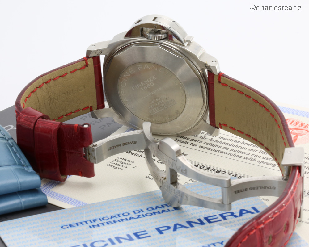 The watch is being offered with the original Panerai steel double folding/locking buckle, instruction booklet, COSC, stamped and dated (now void) warranty card, (lightly worn) matt blue,shiny red and black OP straps. Original light wood Panerai presentation box with strap removing tool and screwdriver.