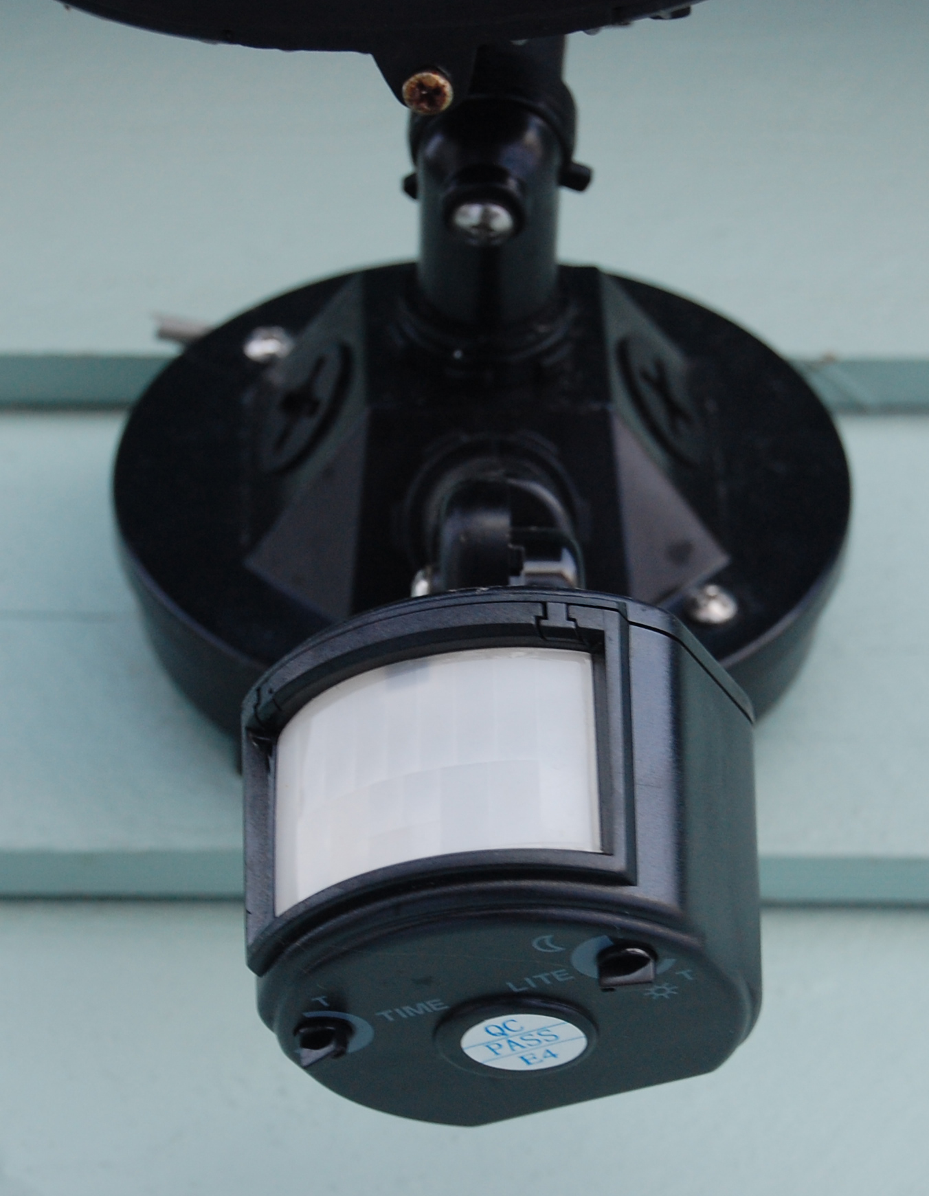Motion detectors like this one can be installed discreetly and efficiently by Cutrona Electric.