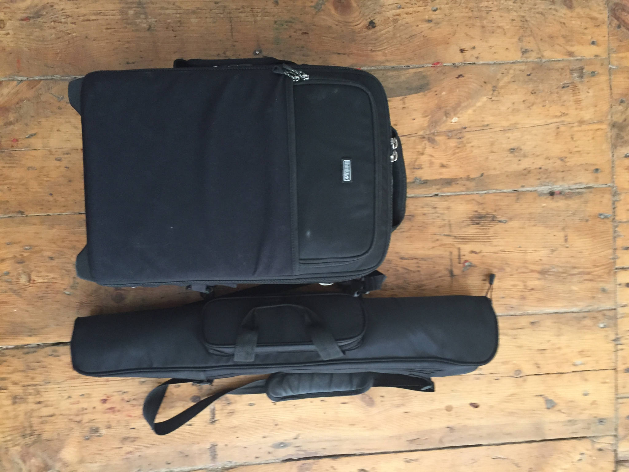 ThinkTank Airport International V2.0 and carry case for the tripod and light stand.