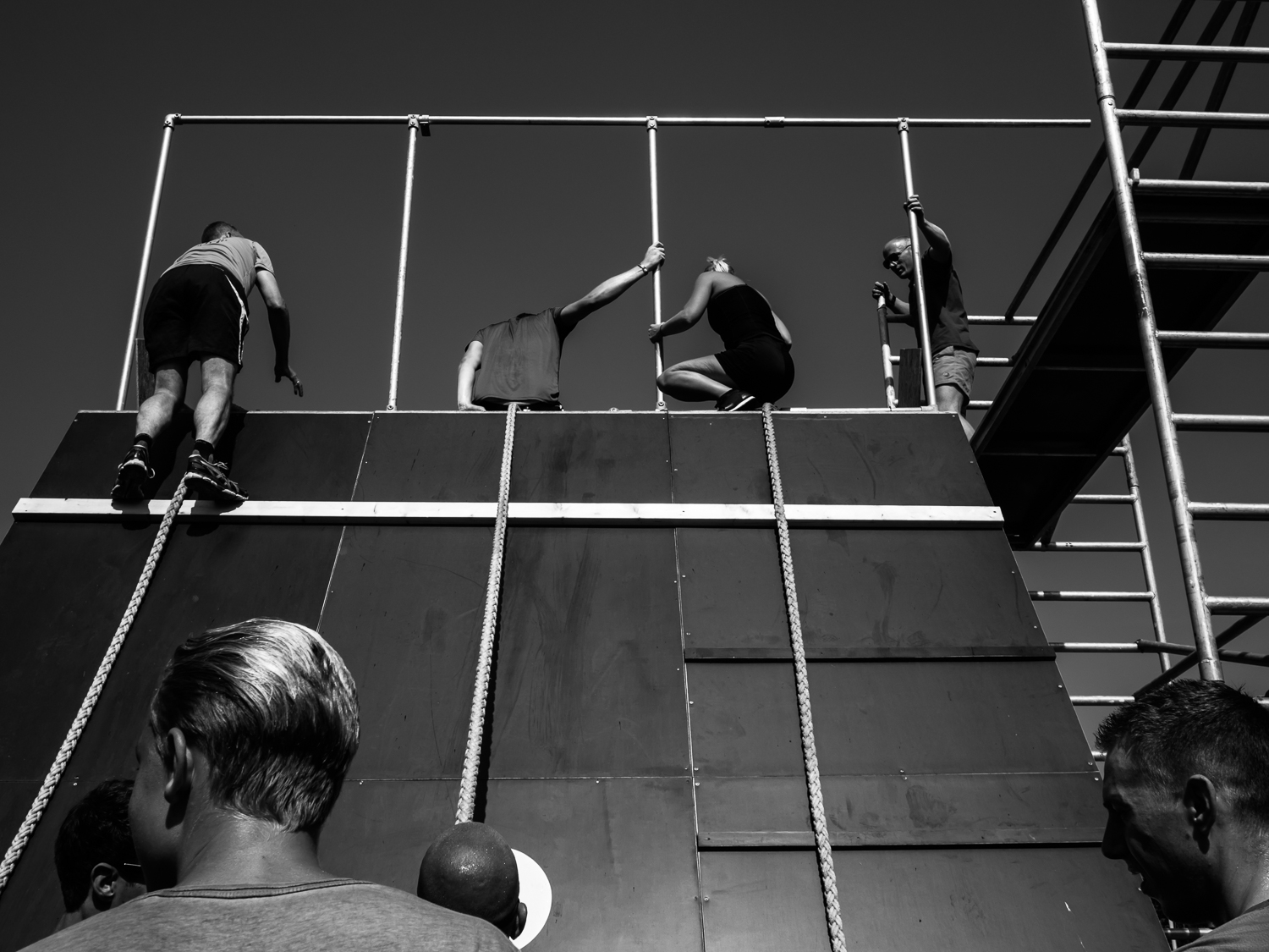 """zwolle AUGUST 2016  Shot taken during the Obstaclerun in Zwolle at the """"Milligerplas"""" just near my house.  The participants are running on a 9 km track and find 8 obstacles they have to take. Here they climb on a slide where they jump into the harbor of the Milligerplas.  Shot with Olympus OMD5 Mark 2 and Olympus 17 mm f/1.8"""
