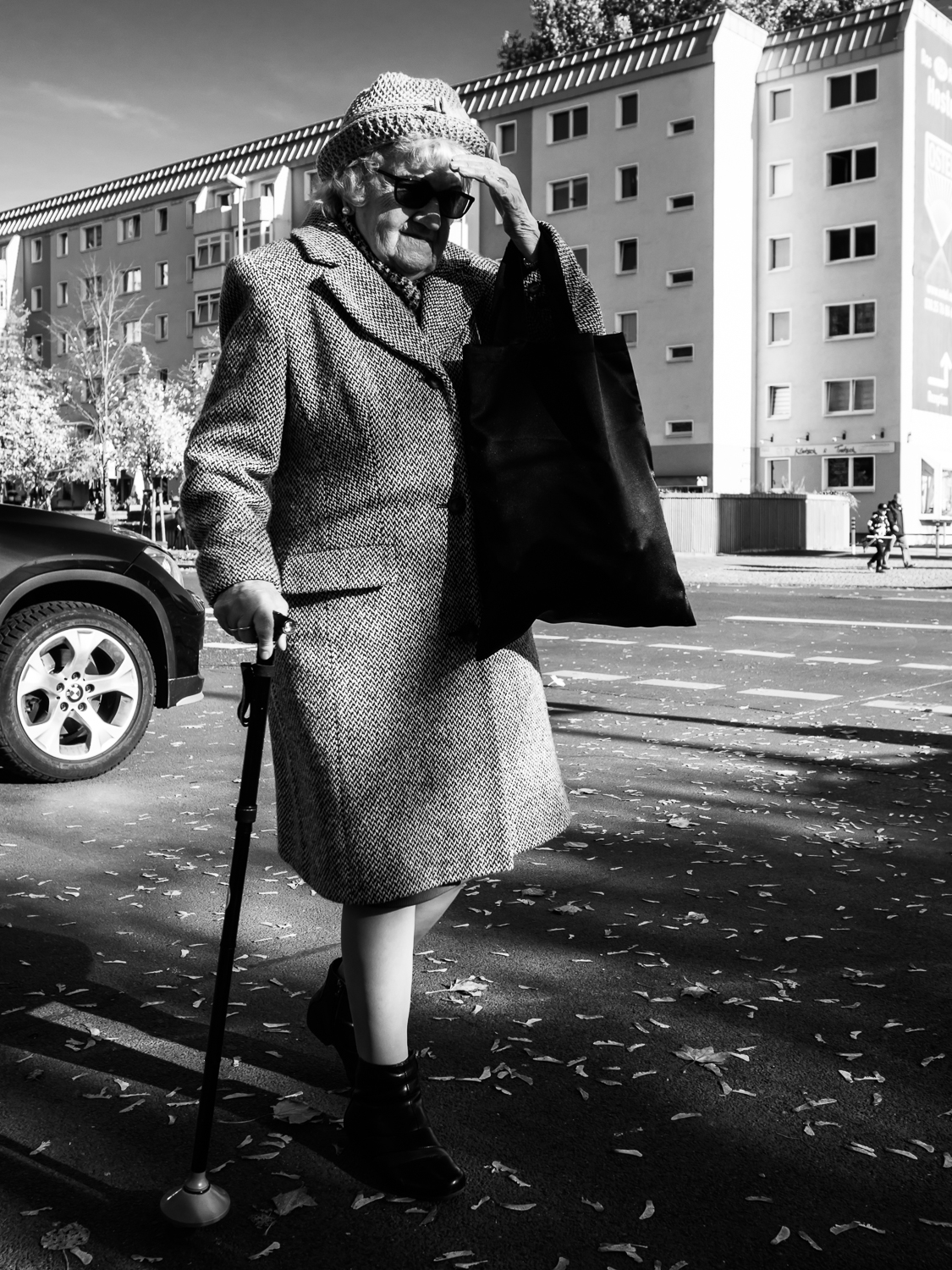 Shot taken in Berlin.  I saw this lady when I walked around in Berlin. She was moving quite slow and I took some photos of her. I am not sure if she saw me or that she just didn't bother.  Shot with Olympus OMD5 Mark 2 and Olympus 17mm f/1.8
