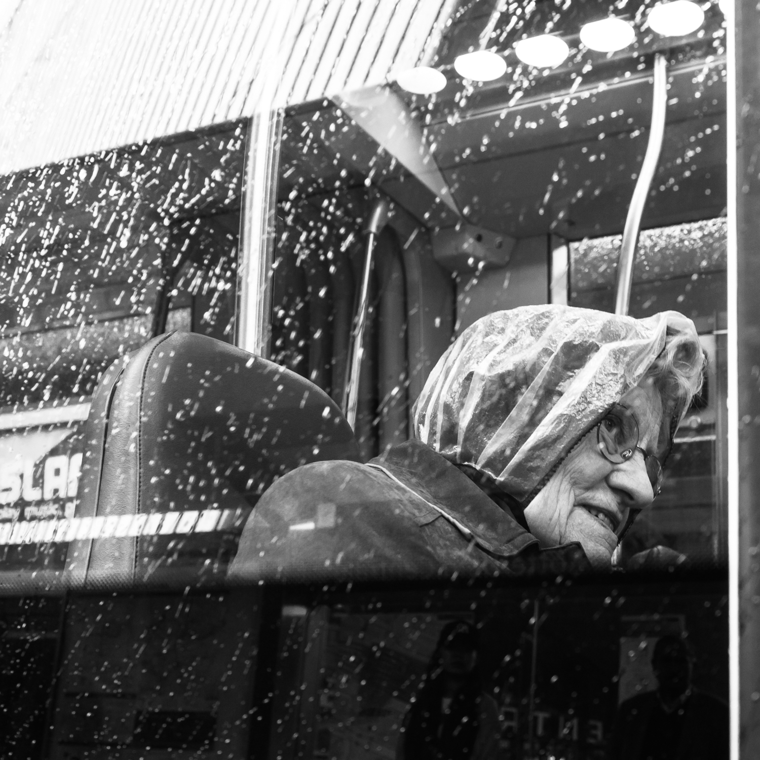 Photo taken in Rotterdam in May 2017 during a workshop I teached. I had some help from one of my participants who stepped into the tram to take a picture of this woman. She smiled very friendly and I like this shot. The rain on the window is always a bonus.  Shot with Olympus OMD1 Mark 2 and Olympus 17mm f/1.8.