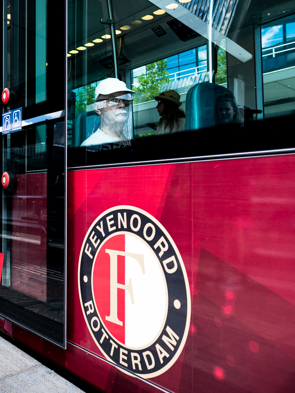 I am a Feyenoord fan since I was a kid. I grew up in the neighborhood of the famous Kuip, the stadium of Feyenoord in Rotterdam. What could be cooler than travelling in a Feyenoord tram, this guy must have thought. Although he saw me, he did not flinch. Welcome to my   Glassy   series. August 2018.  Olympus OM-D E-M1 Mark 2 with Olympus M.ZUIKO 17mm 1:1.2 PRO