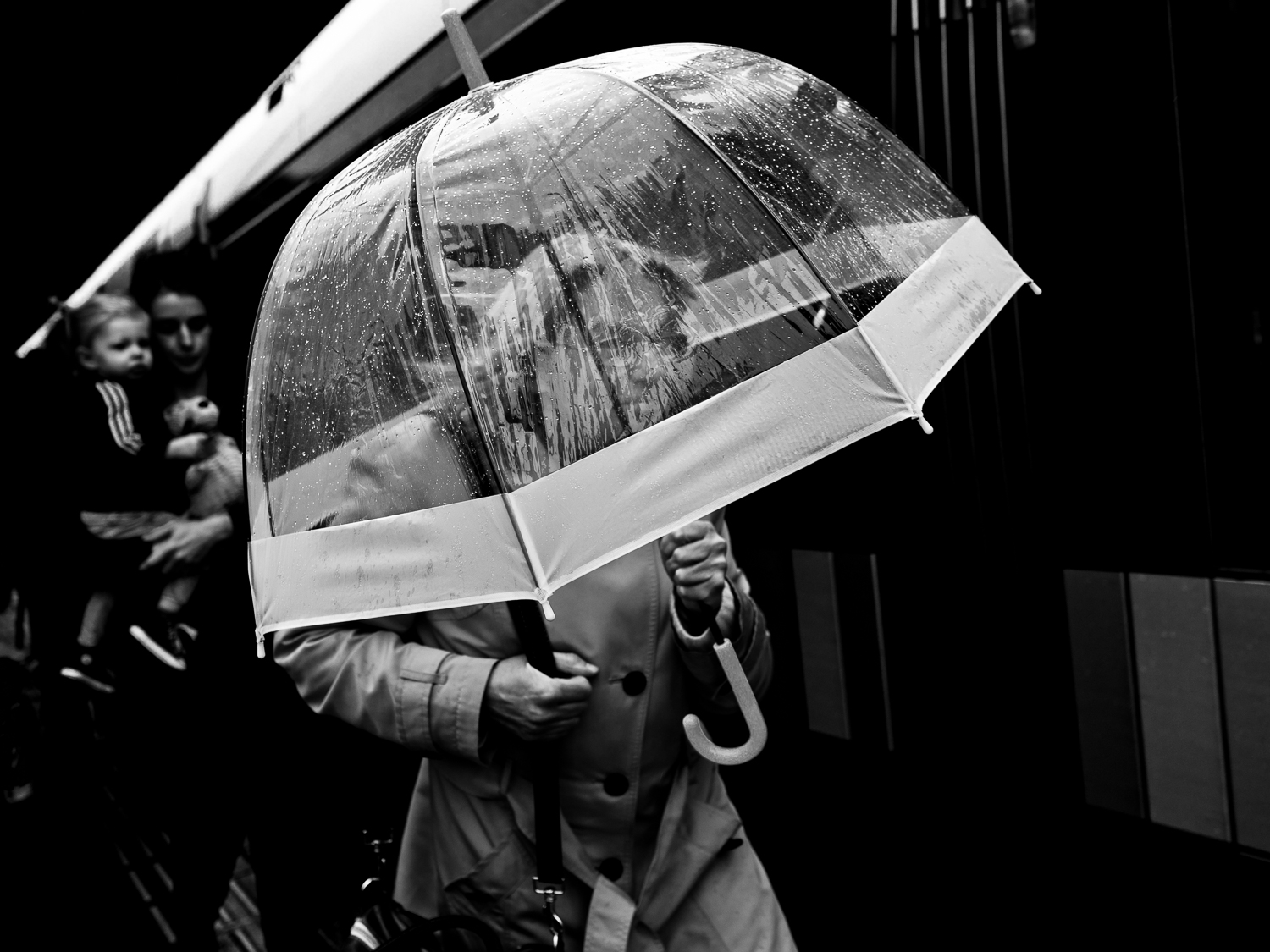 I made this photo during my Advanced workshop street photography in Rotterdam in September 2018. Although her face is a bit visable under the umbrella I think she is not really recognisable. Therefore she can be part of my   Undercover   series. During my Advanced workshop I ask my participants to also look for Undercover shots. They find that a challenging assignment.  Olympus OM-D E-M1 Mark 2 with Olympus M.ZUIKO 17mm 1:1.2 PRO
