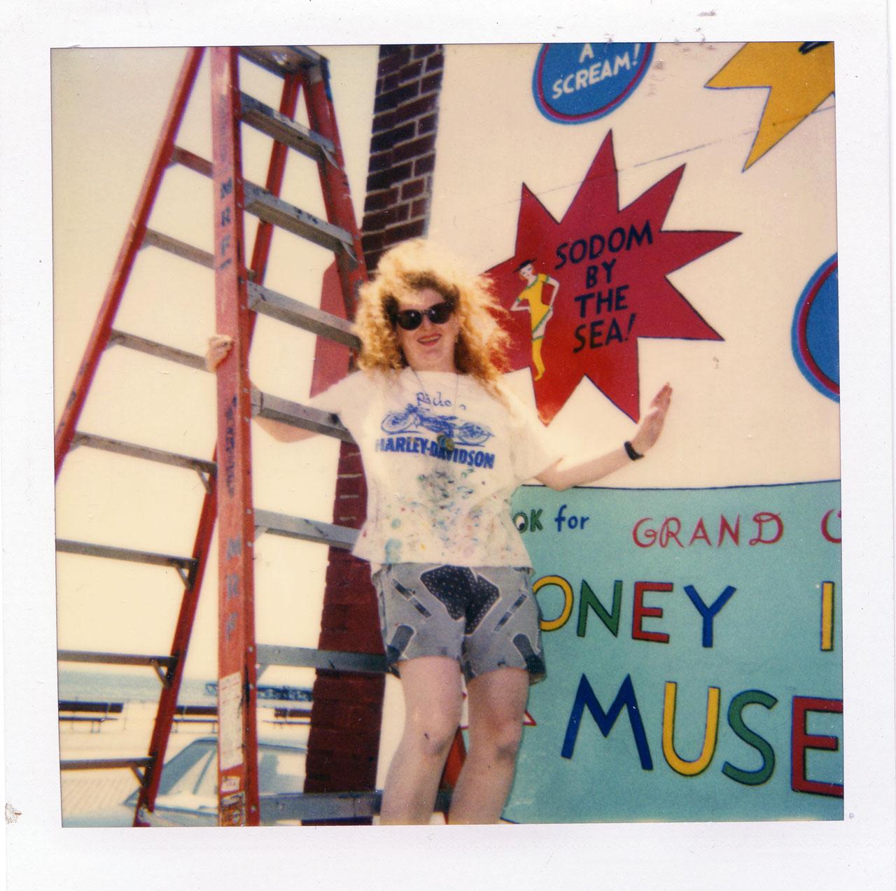Artist Julie Wilson painting a Coney Island mural.