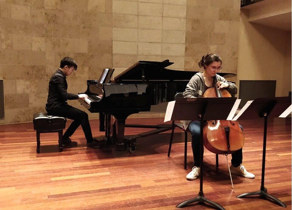 """With Emily Yoshimoto, cello, performing Sato Matsui's """"Hop Hop Bunny""""   2019"""