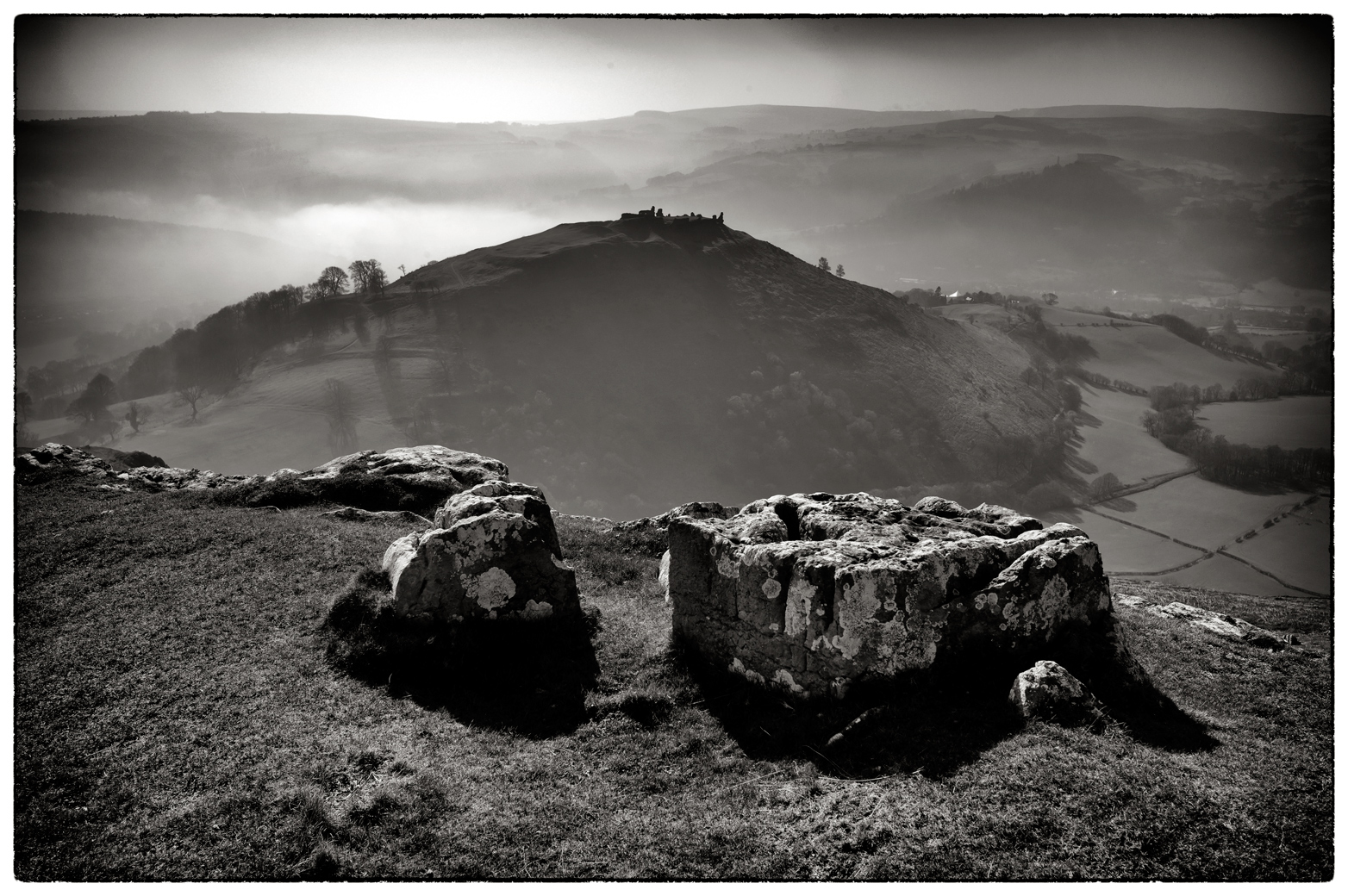 Dinas Bran silhouetted through the mist.