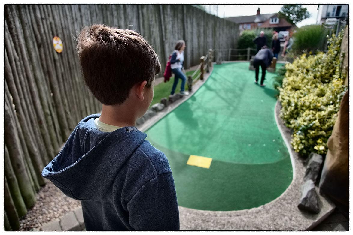 Ben watching Crazy Golf in Skegness.