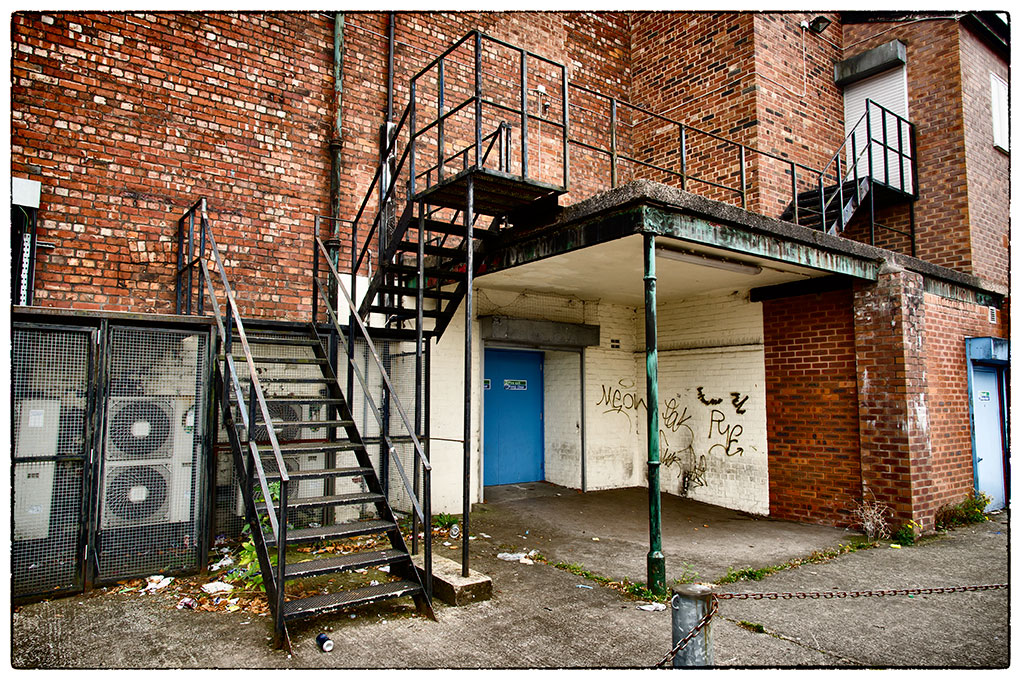 The back door to the old Supermarket at Hyde. Now sadly disused. The number of times I've run through that door! Usually heading towards Hubble's record shop.