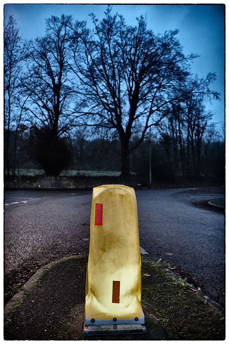 Sunrise in Cefn-y-Bedd, where the brightest object is this battered bollard!