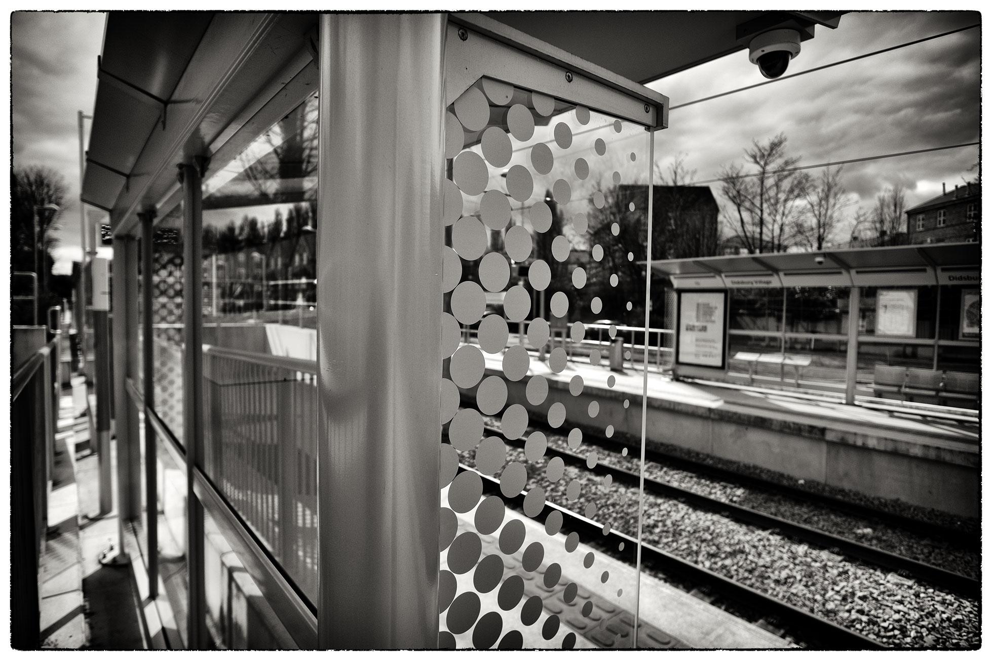 An empty Didsbury tram station.