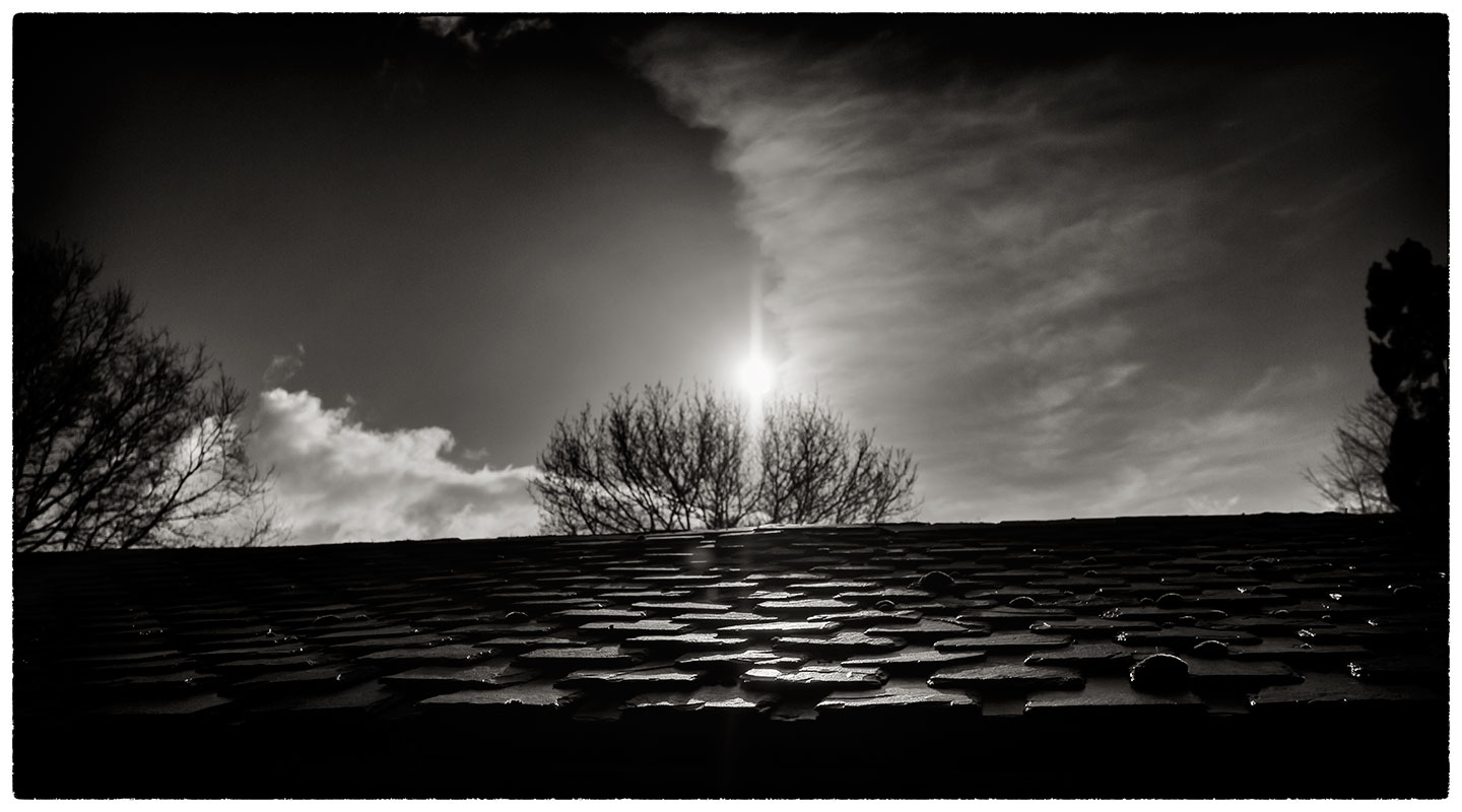 Morning sun on an old slate roof.
