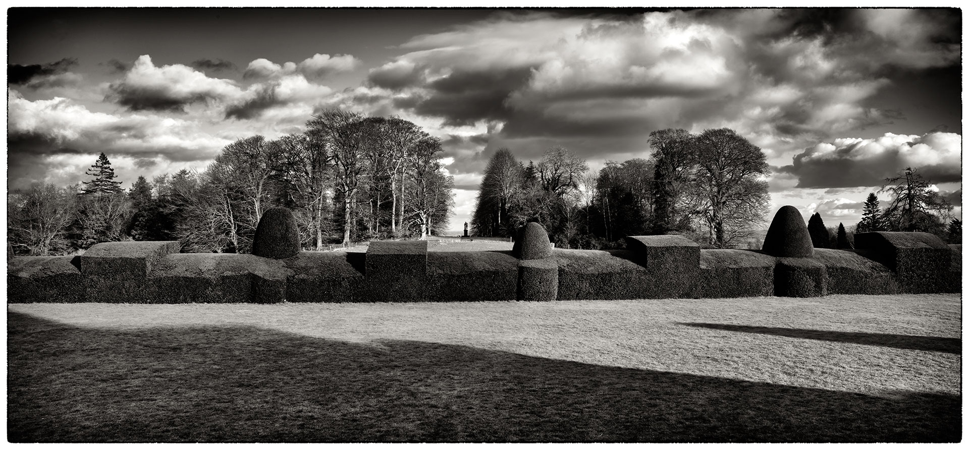 More topiary and long shadows at Chirk Castle.
