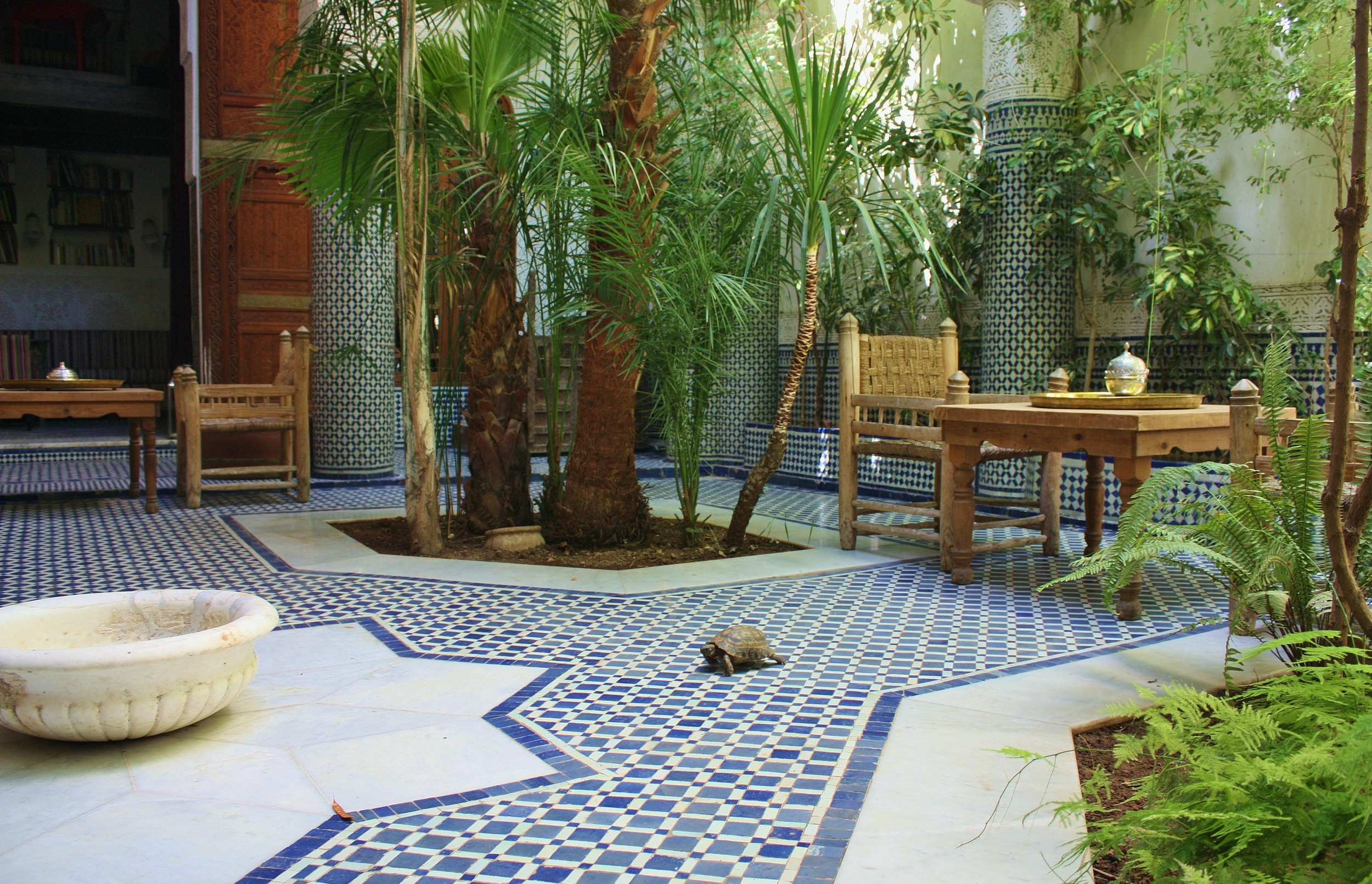 My private oasis: riad courtyard in the old city of Fez in Morocco. Most riads abound with fountains and luxurious textures of tile-work and and hand-carved wood and plaster arts.
