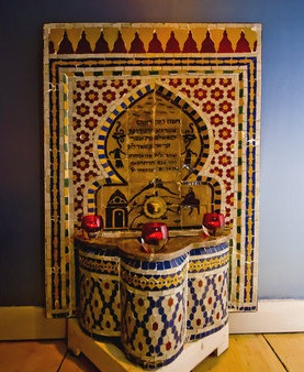An antique fountain brought from a riad in the old city of Fez in Morocco is one of many authentic furnishings for guests to enjoy in the Moroccan Suites in Boston.
