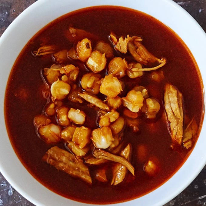 POSOLE - This savory New Mexican stew served on Saint's Day feasts at pueblos and Christmas and New Year's gatherings of families and friends, can be enjoyed for dinner or a side for main dishes like enchiladas.