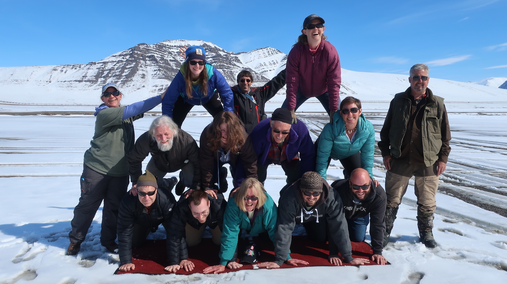 NATC tour guide's tradition of building a human pyramid at the Arctic Circle during training in May has now moved north to Galbraith Lake....