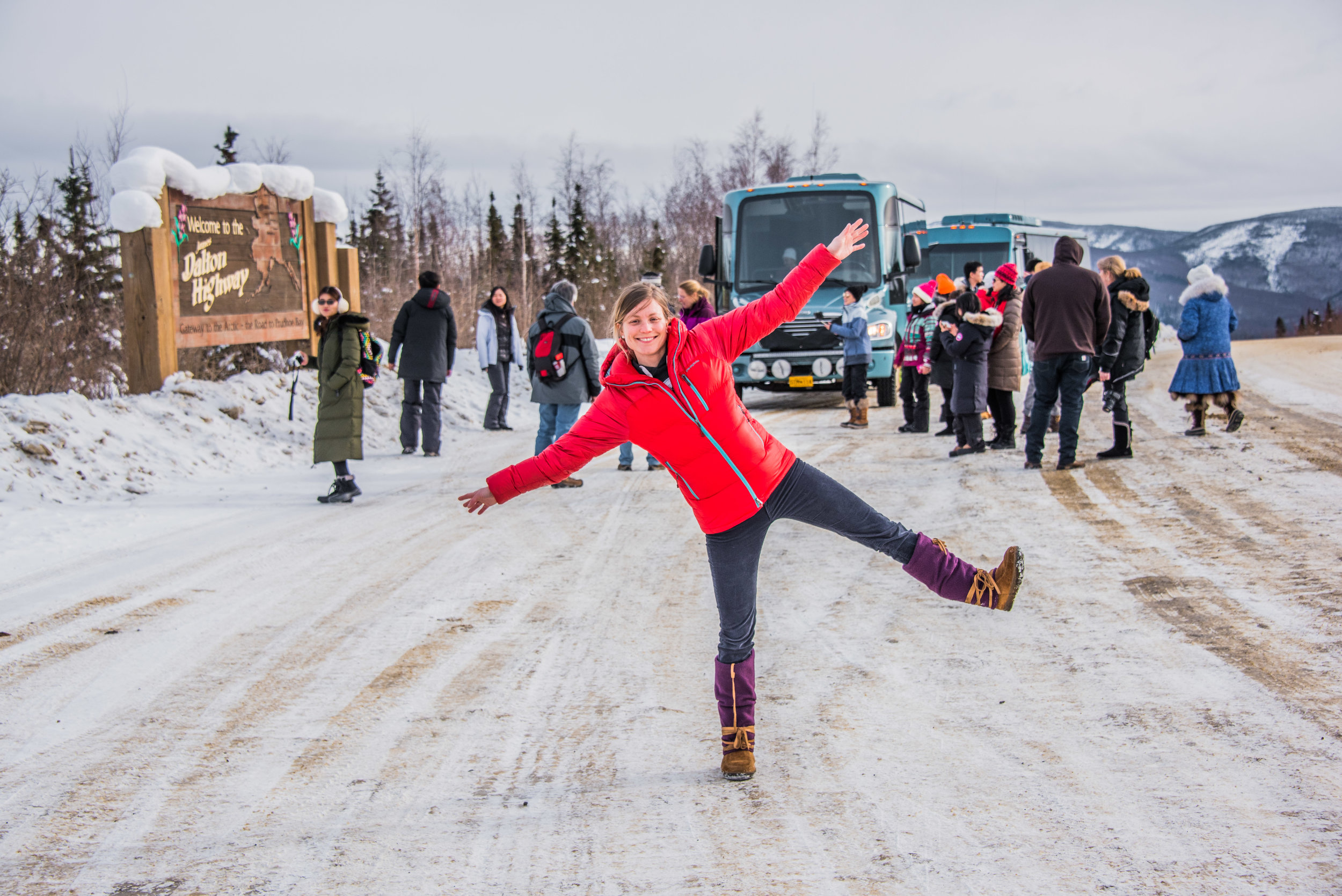 Guests starting their journey on the famous Dalton Highway, with a stop at Mile 1 for photos