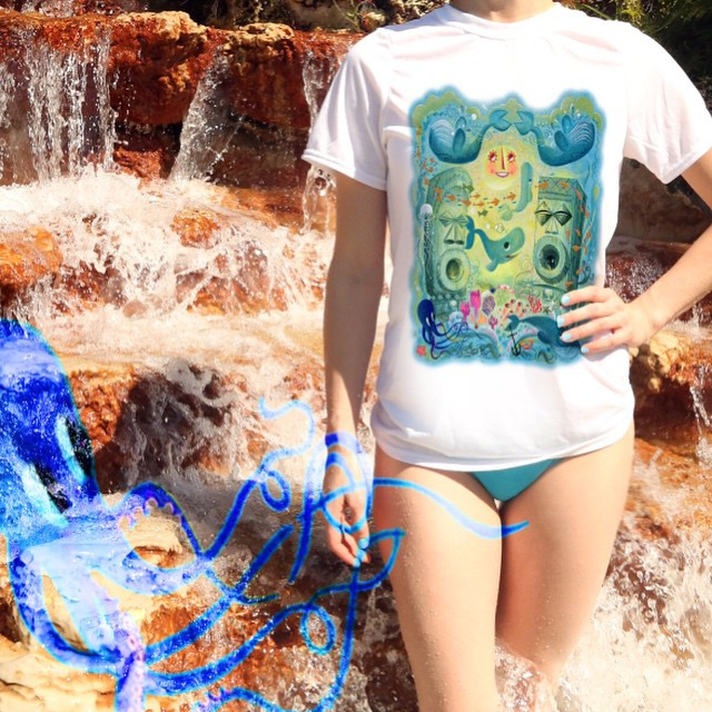 """Ultra soft sublimated """"#OCTOPUS #GARDEN"""" #FineArtPrint by renowned #artist """"#MILESTHOMPSON"""" printed on front of this luxurious white unisex T-Shirt. This unique print will drown out the #blues.  Great for a day on the #beach, #surfing, watching the #littlemermaid, and your self-esteem.  THIS SHIRT WOULD MAKE YOU MUCH COOLER , AND SIGNIFICANTLY MORE ATTRACTIVE."""