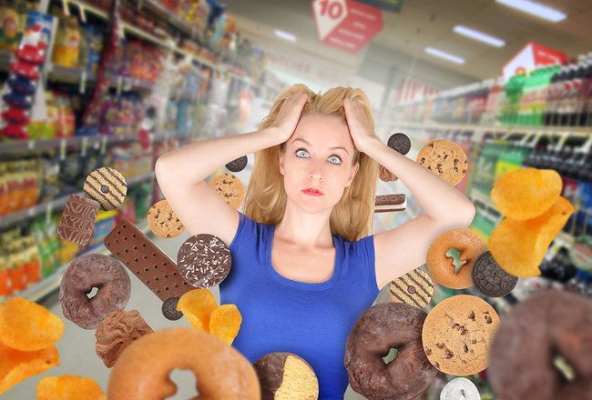 woman with floating junk food 650 X 400.jpg
