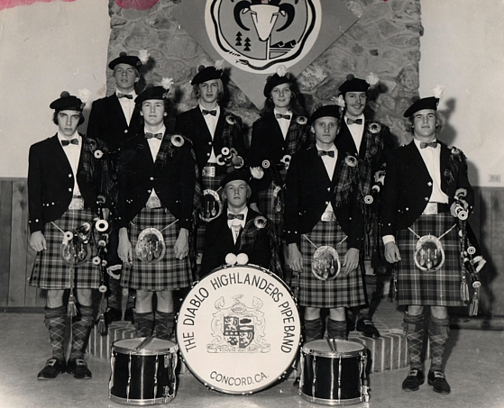 Photo courtesy of Jeff Campbell  1976 (approximately) at our practice hall in Lafayette. Top row: Stuart Watson, Kevin McNeil, Shauna McFadden, Jeff Campbell. Second row: Ed Aiken, Dave Meade, Bill Meade, Bill McNeil Jr., Andrew Christie