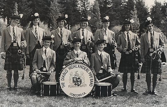 Photo courtesy of Jeff Campbell  1972 Santa Rosa Highland Games. Left to right Andrew Christie, Shauna McFadden, Joe Christie, Kevin McNeil, Stuart Watson, Jeff Campbell, Ed Aiken. Bottom row: Bill McNeil, Bill Meade, Dave Meade