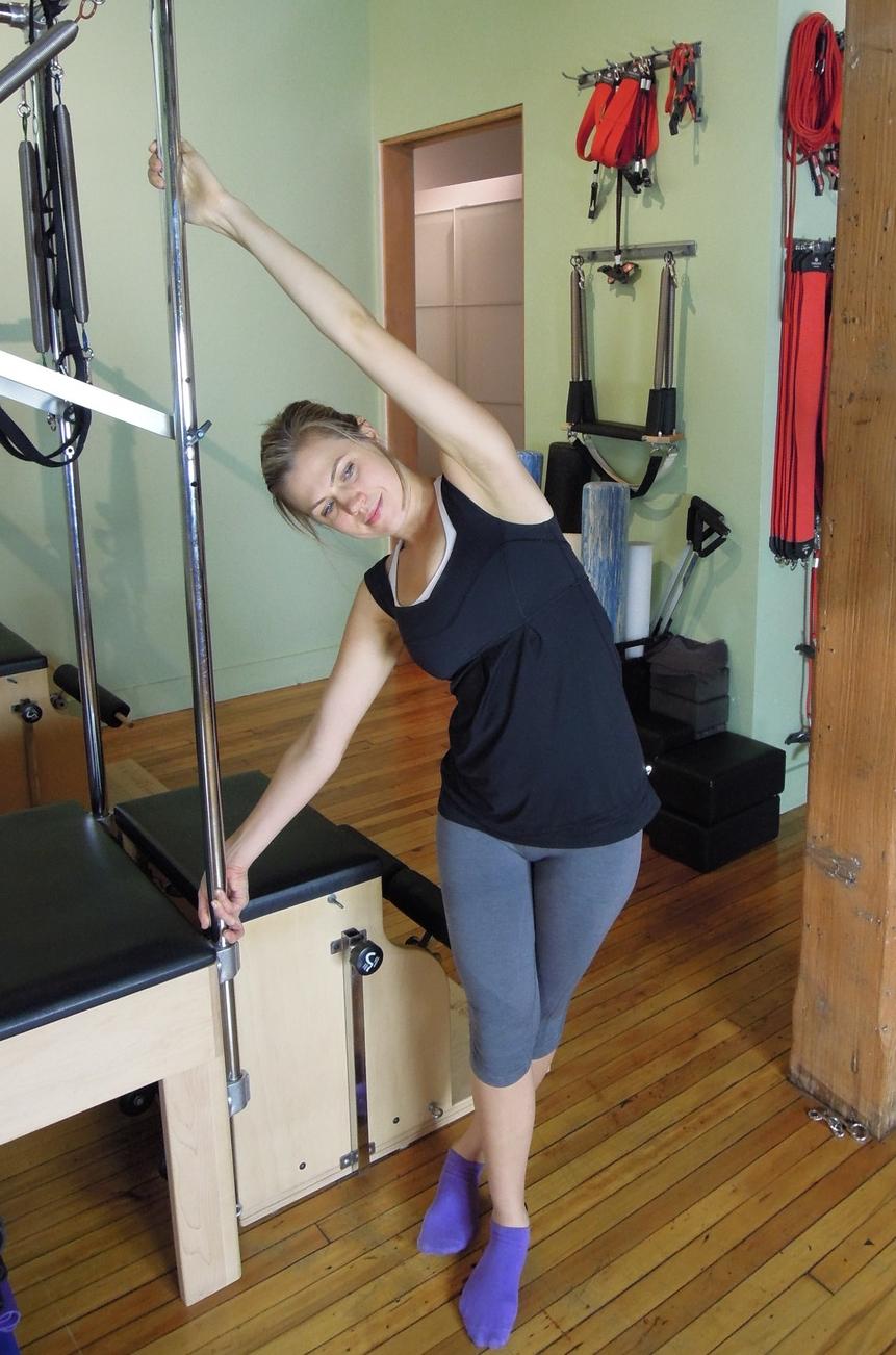 Standing side flexion stretch
