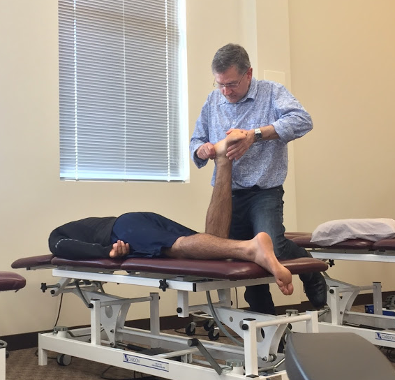 Michael performing an interface-directed manual treatment for tarsal-tunnel syndrome.