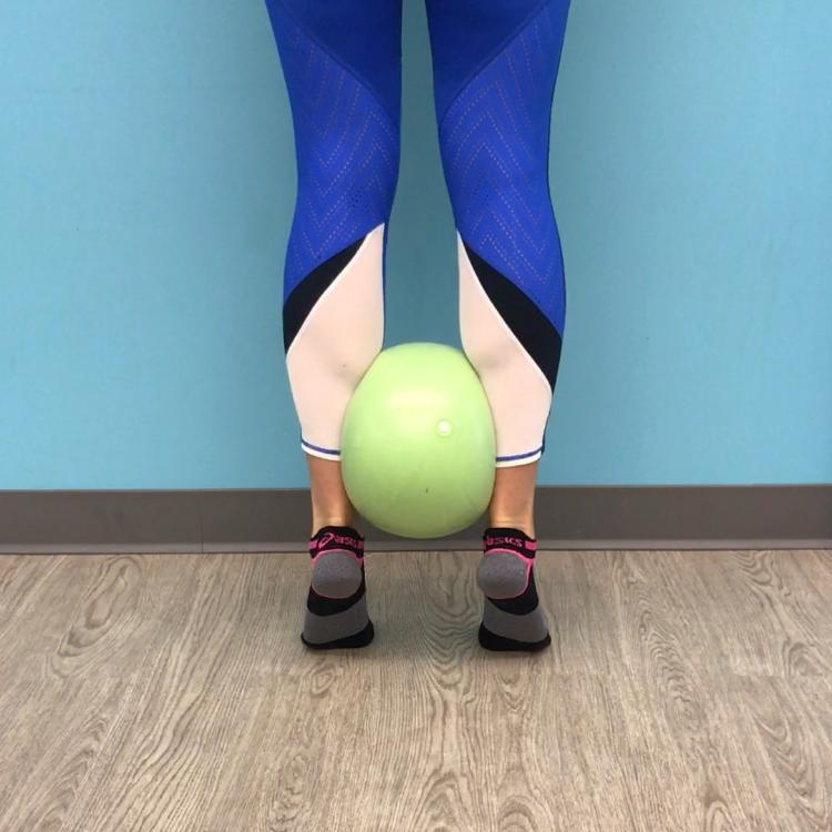 Double leg calf raise with ball squeeze